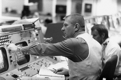 Gene Kranz in mission control wearing one of his famous vests
